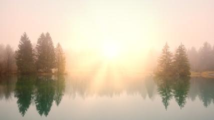 Sunrise at a lake on a foggy morning Fototapete