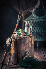 Old angler equipment with floats, hooks and rods