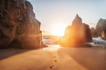 beautiful sandy atlantic ocean beach on sunset. Sintra, Portugal