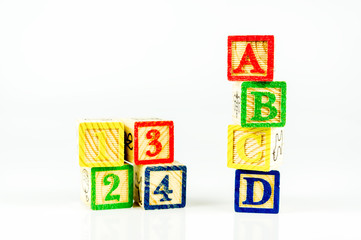 Close up arrangement of alphabet isolated on white background. Preschool, education concept or other your content.