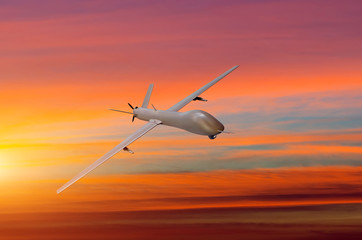 Unmanned military aircraft on white background sunset sky.