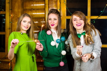Girls on a home party wearing green outfits