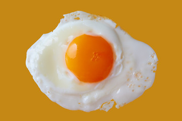 Photo sur Toile Ouf Fried Egg Close-up On Yellow Background