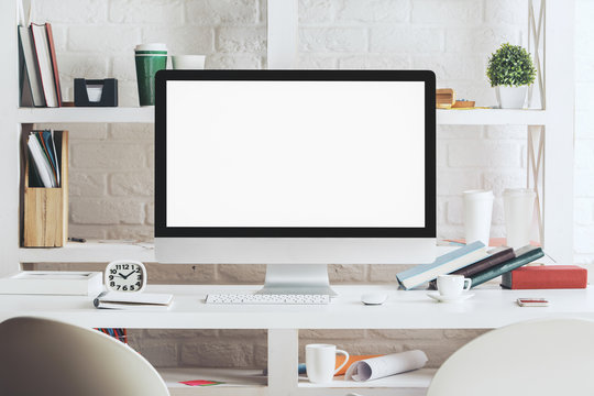 Hipster desktop with blank white computer