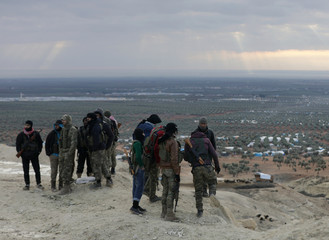 Turkey-backed Free Syrian Army fighters are seen in Barsaya mountain, northeast of Afrin