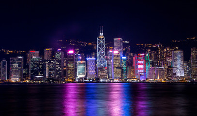 Hong Kong, China. August 30, 2017.  Skyline at night with lights and skyscrapers over sea with laser beams. Fotomurales