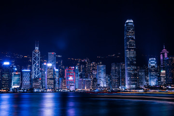 Hong Kong, China. August 30, 2017.  Skyline at night with lights and skyscrapers over sea with laser beams.