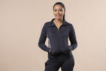 charming beautiful young woman posing in sportswear smiling isolated