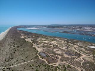 Tavira (Portugal) ciudad portuguesa de la costa del Algarve  que desemboca en las lagunas del parque natural de Ría Formosa. Fotografia aerea con Drone