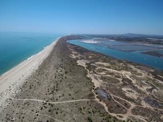 Playa de Tavira (Portugal) ciudad portuguesa de la costa del Algarve  que desemboca en las lagunas del parque natural de Ría Formosa. Fotografia aerea con Drone