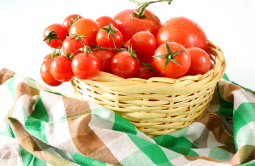 Many tomatoes in the basket