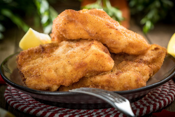 Fried cod slices in breadcrumbs.