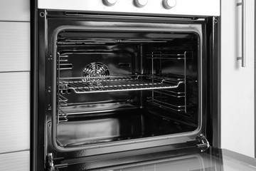 Empty electric oven in kitchen, closeup