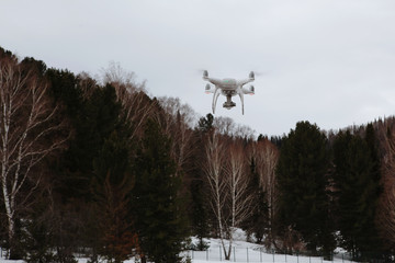 drone in flight in mountains