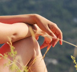 Beautiful hands of  woman and nature