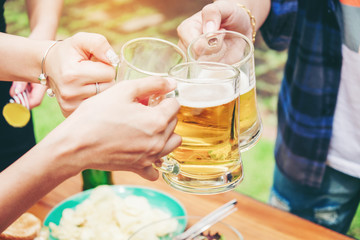 Group of young asian people celebrating beer festivals happy while enjoying home party