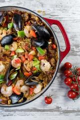 Mediterranean Paella in cast iron dish top view closeup