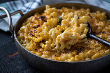 gourmet baked macaroni and cheese noodles in rustic cast iron dish