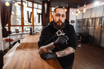 Portrait of professional creative tattoo master