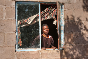 African woman in the window