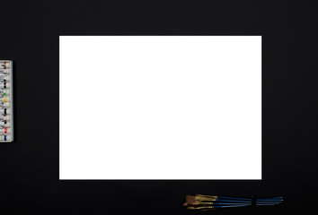 Blank frame for painting and paint with  paint brushes