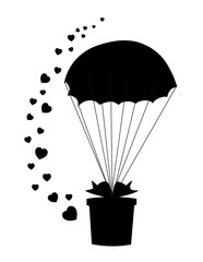 Black silhouette of  gift on  parachute and many hearts around.