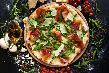Foto auf Acrylglas Pizzeria Salmon and arugula pizza. Light and tasty restaurant meal for a foodie