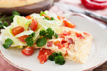 Spicy Omelette with ham, tomatoes, pepper, cheese and herbs