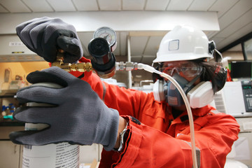 Instrument technician is take standard gas for the job calibrate or function check of personal gas tester or gas detector.