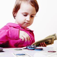 The concept of gambling addiction. The little child girl gambler Plaingy Poker Games.