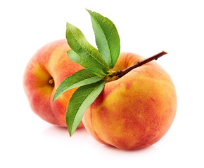 Fresh peach with leaves
