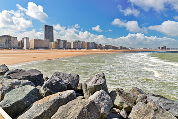 Fotobehang Noord Europa View from the sandy beach on the city. Summer day in Ostende, Belgium