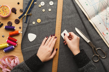 Top view on fashion designer working at messy table