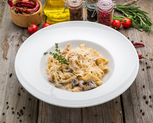 Creamy mushroom spinach pasta. toning. selective focus