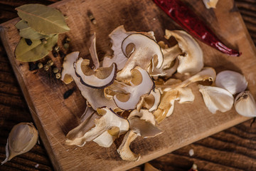 Dried porcini mushrooms on a wooden table. Food background. Rustic style.