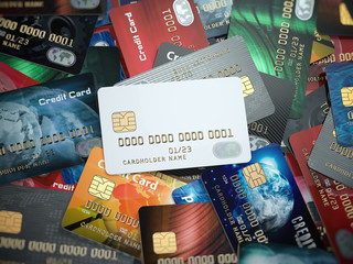 White blank credit cards mockup onthe background of colorful credit cards of the different banks.