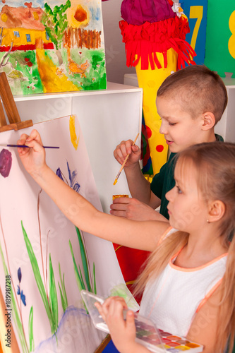 Children Painting On Easel Spring Flowers Girl With Boy Learn Paint