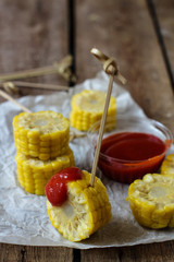 boiled corn slices with tomato sauce - a useful snack
