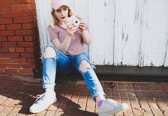 Teen Girl Taking Pictures in Town