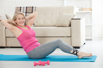 Middle-aged woman in her 50s stretching for exercise