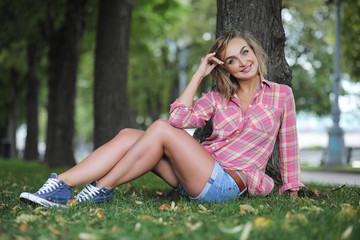 Beautiful girl in the summer park