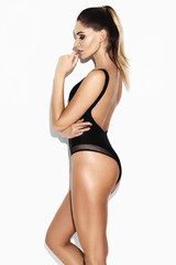 sexy woman in black swimsuit on a white background