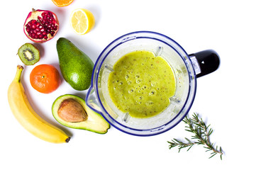 Avocado smoothie in a blender with various ingredients