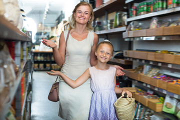 Portrait of young woman and girl shopping