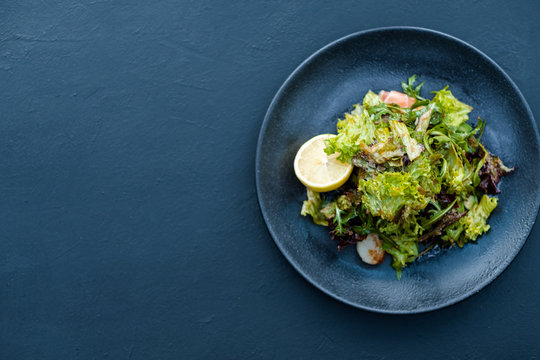 salad plate on blue background. Tasty fresh food. Balanced nutrition
