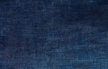 Jeans background. Jean texture. Blue jeans pattern no seam with macro style to preset about classic fashion cloths concept. Indigo color fabric.