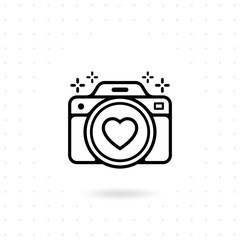 Camera icon. Vector for web and mobile applications. Photo camera outline vector icon. Camera icon with a heart symbol on the lens. Photography Vector illustration
