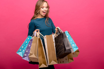 150e1e0c1 portrait of beautiful cute happy sweet surprised blonde woman girl looking  in big shopping bag