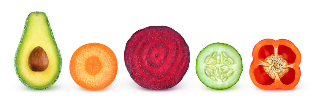 Isolated vegetable slices. Fresh vegetables cut in half (avocado, carrot, beetroot, cucumber, bell pepper) in a row isolated on white background with clipping path