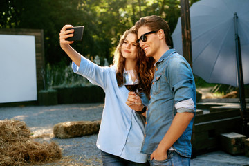 Happy Couple Taking Photos And Having Fun In Nature On Weekend